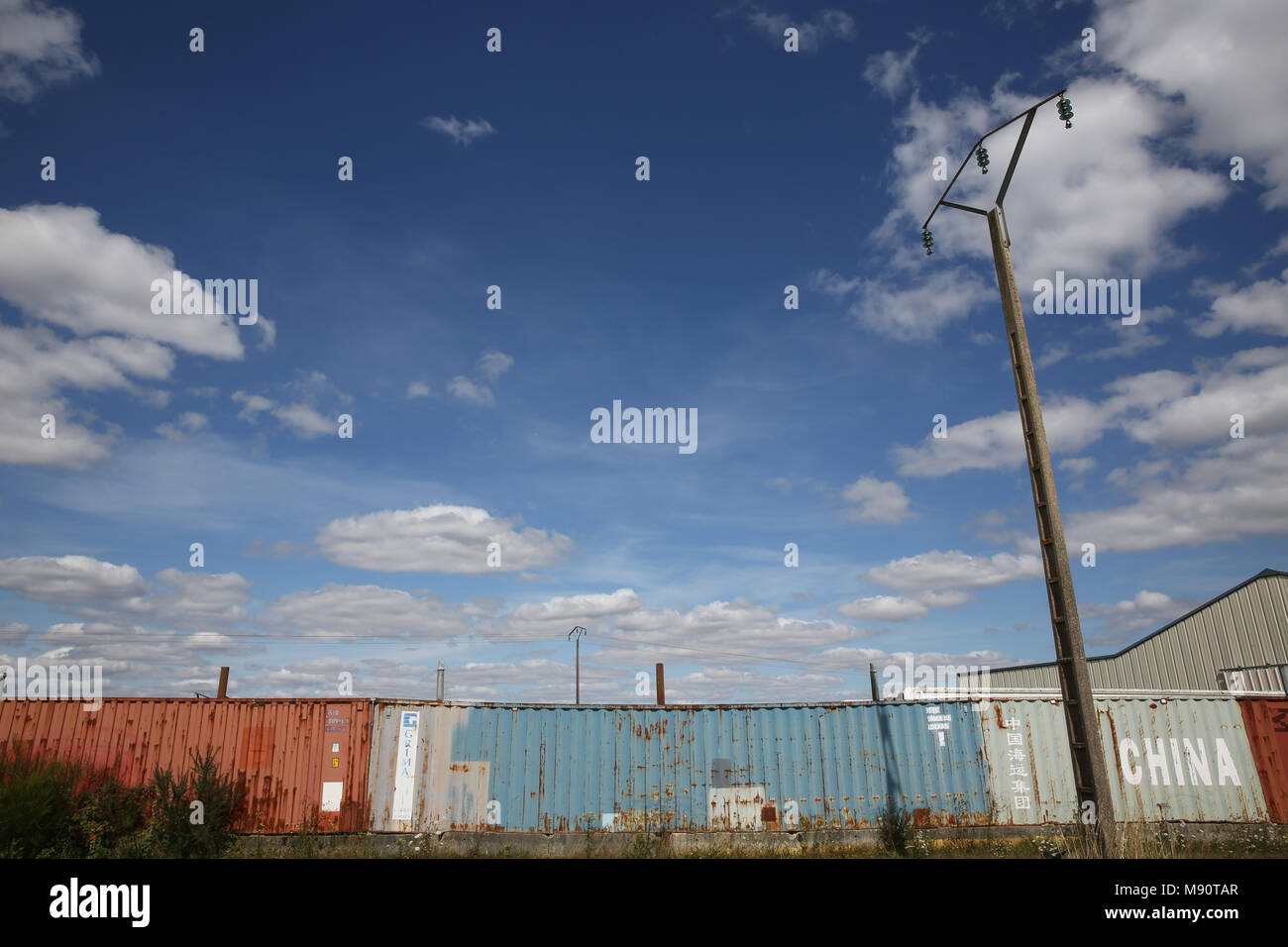 Wall made of discarded containers. Eure, France. - Stock Image