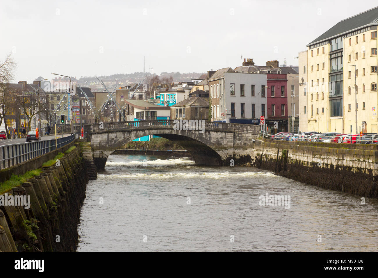Parliament Bridge and the narrow streets of Cork Ireland on the Father Mathew Quay alongside the River Lee that runs through the city Stock Photo