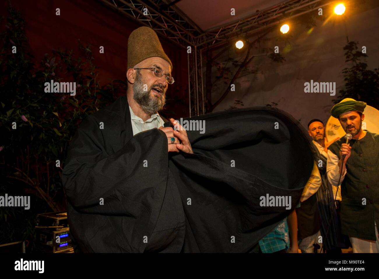 Sufi music concert at the Institute of Islamic Cultures, Paris, France. Whirling Dervish. - Stock Image