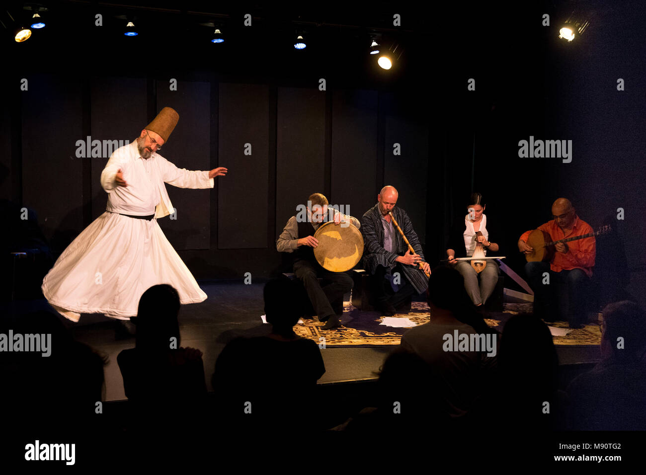 Whirling dervish and Lalé ensemble at the Mandapa centre, Paris, France. - Stock Image
