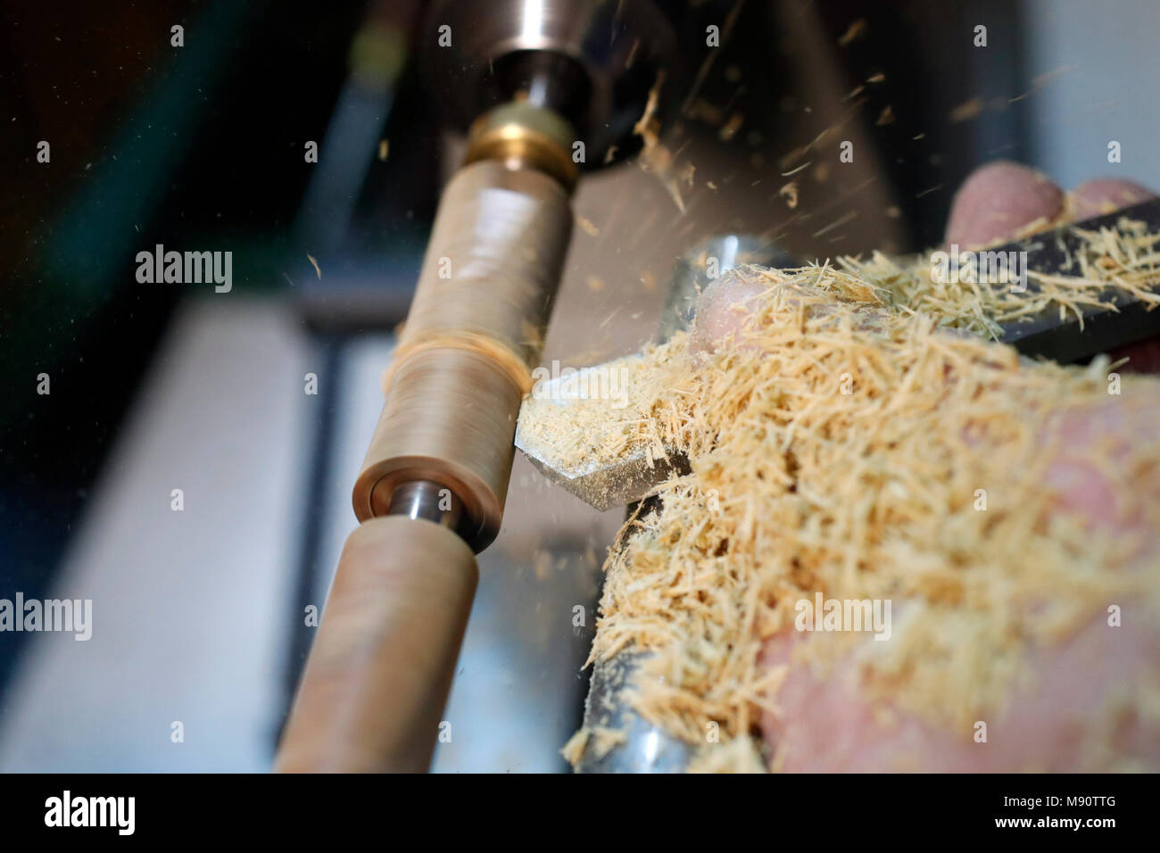 Man working on a wood lathe. - Stock Image