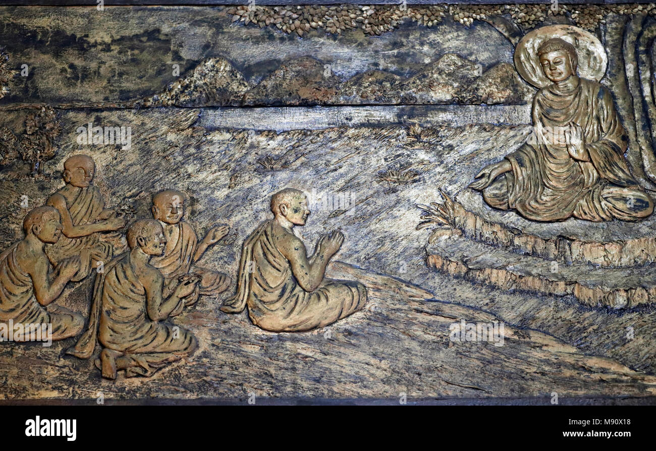 Chua Ho Quoc pagoda. The life story of Shakyamuni Buddha. The first discourse. The Buddha preaching the sermon - the wheel of law - to his five discip - Stock Image