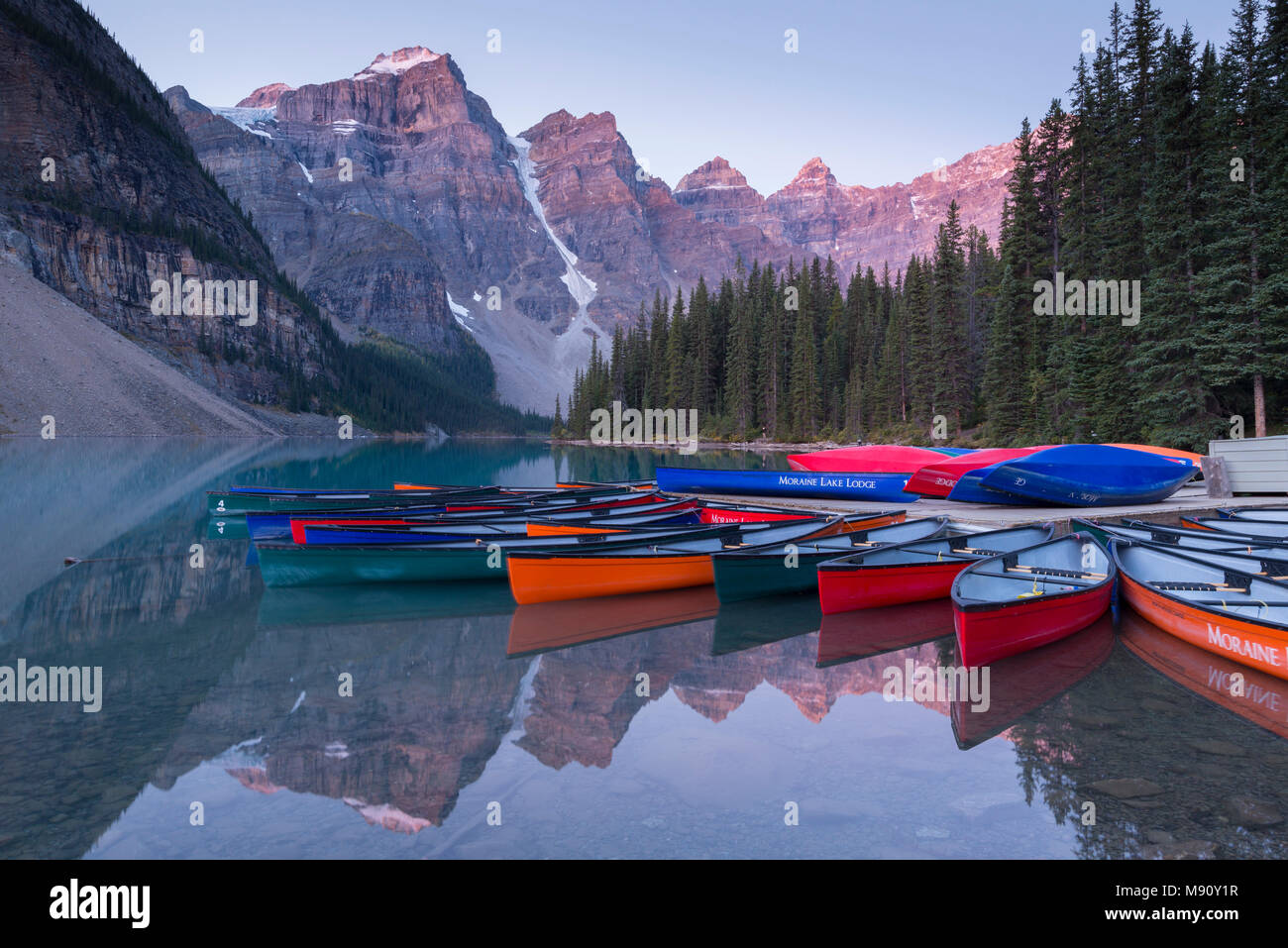 Canoes On Moraine Lake At Dawn In The Canadian Rockies