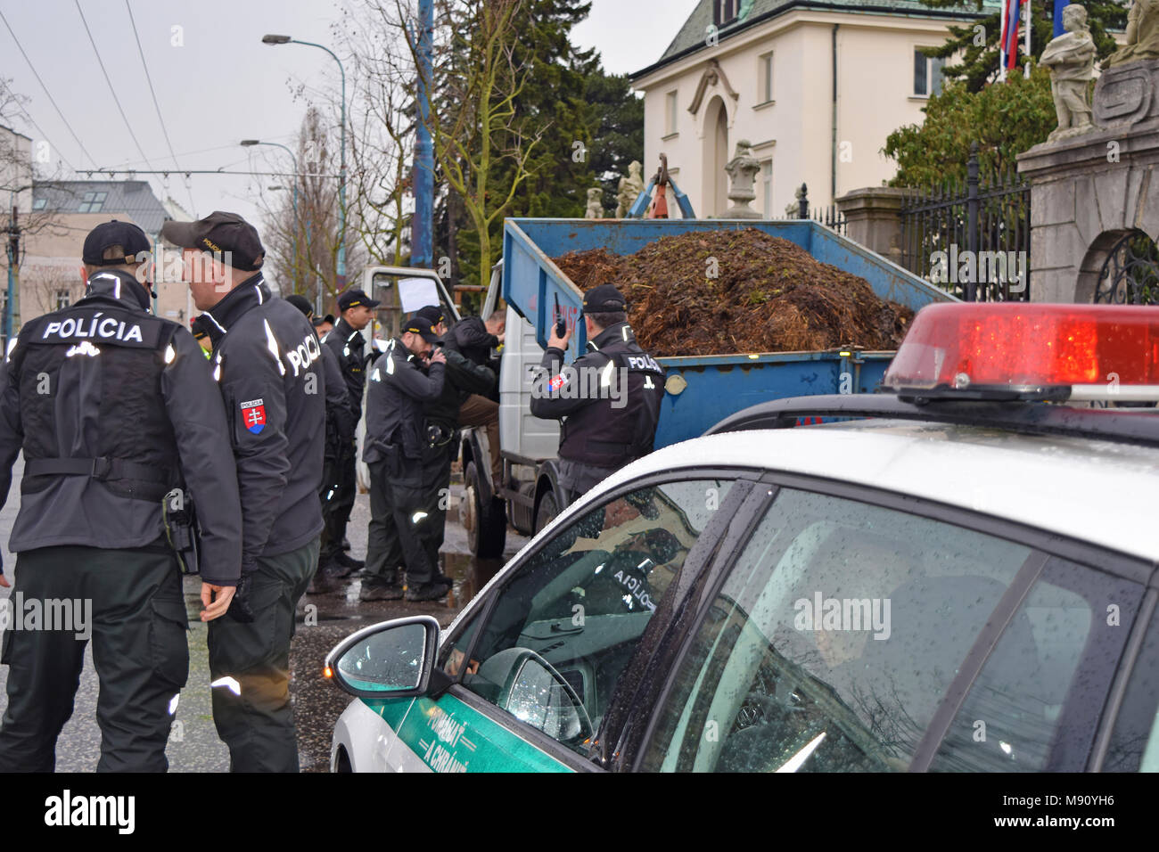 Bratislava, Slovakia. 16 March 2018. Police inspects the driver of the car that brought the cargo of manure in front of the Government Office Stock Photo