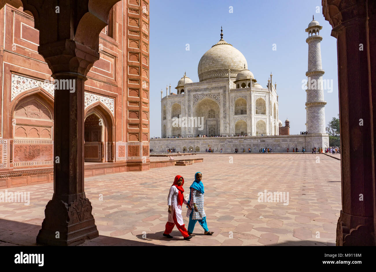 Agra, India - March 03, 2018: Two Indian women at Taj Mahal. The Taj Mahal is an ivory-white marble mausoleum and most popular landmark in India. - Stock Image