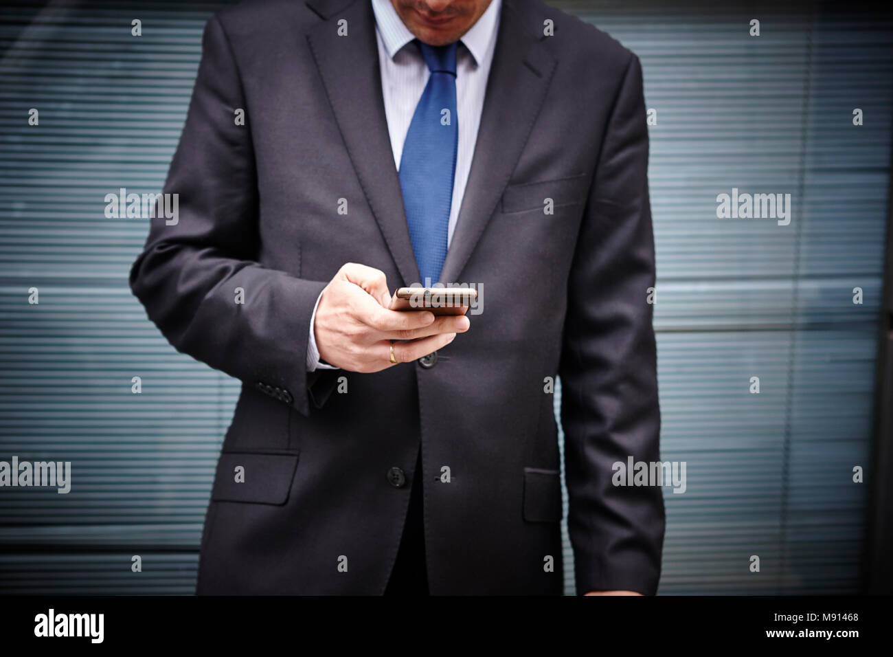 Business man texting with mobile phone. Working time. Outdoors. Message - Stock Image