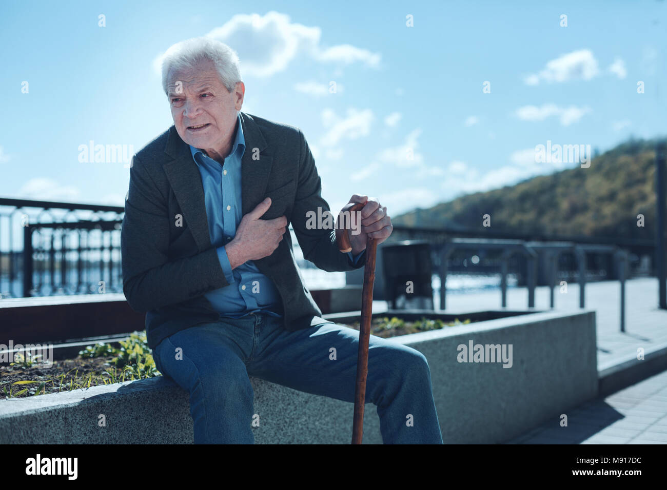 Retired man suffering from heart pain - Stock Image