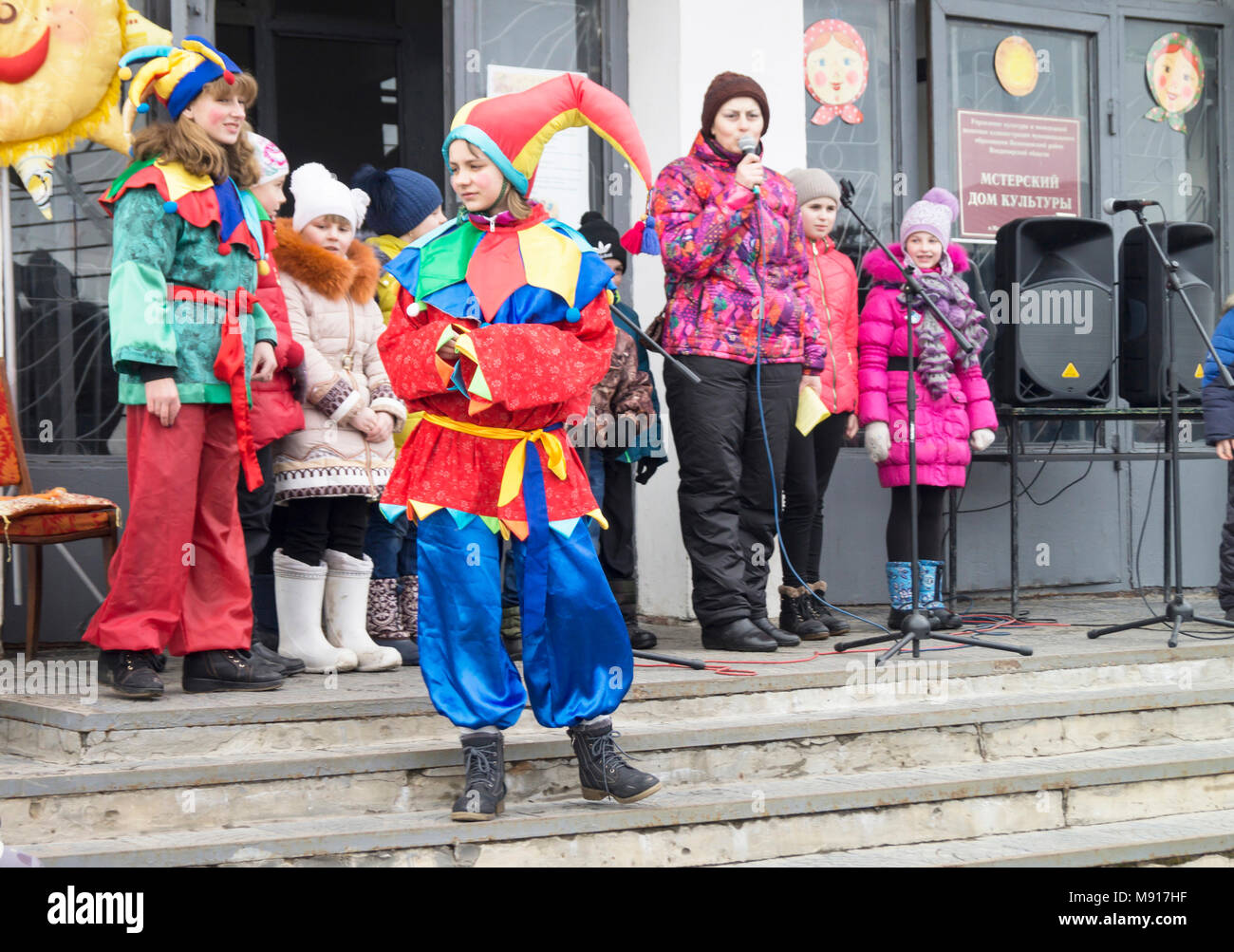 Mstera,Russia-March 13,2016: Appearance actor in colorful gown at festive day of the Shrovetide March 13,2016 in city Mstera,Russia - Stock Image