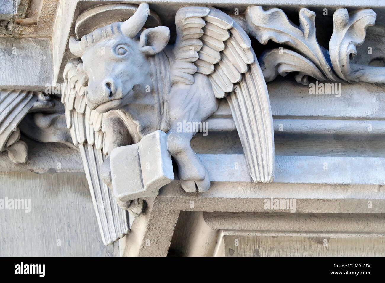 St Nicholas Cathedral. Saint Luke's and The Winged Ox. Statue.  Fribourg. Switzerland. Stock Photo