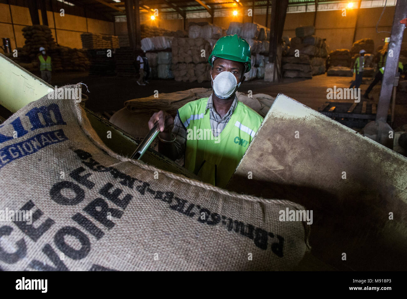 Cocoa humidity check at Abidjan port facilities, Ivory Coast. - Stock Image