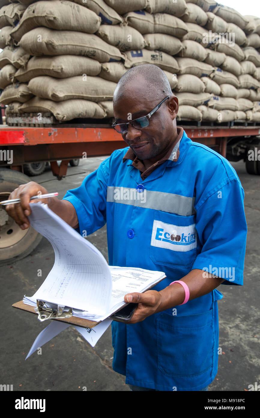 Employee at Abidjan port facilities, Ivory Coast. - Stock Image