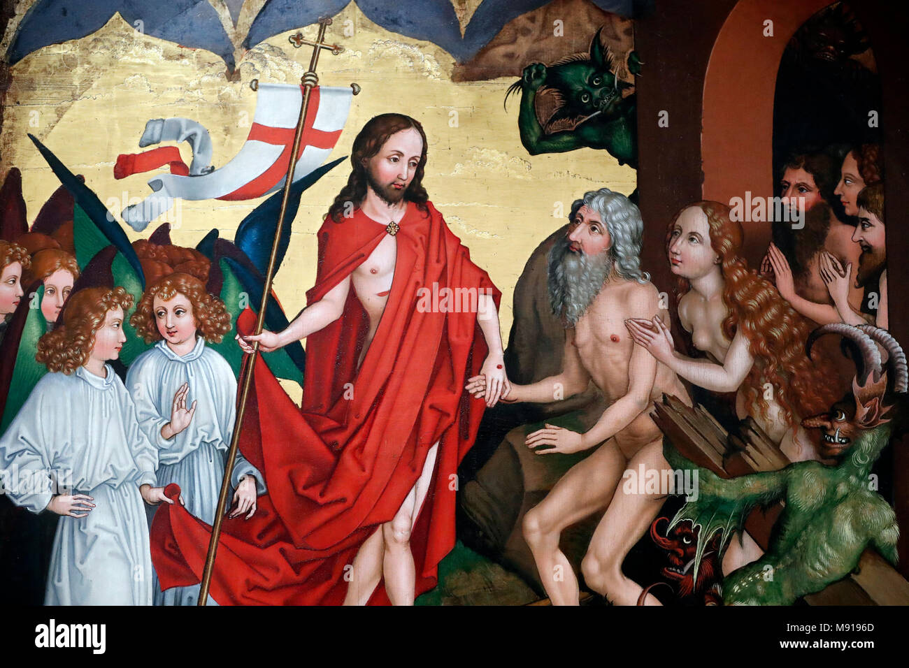Unterlinden Museum.   Jesus pulls Adam and Eve out of their graves at resurrection.  Oil on wood panel. Martin Schongauer. Late 15 th century.  Colmar - Stock Image
