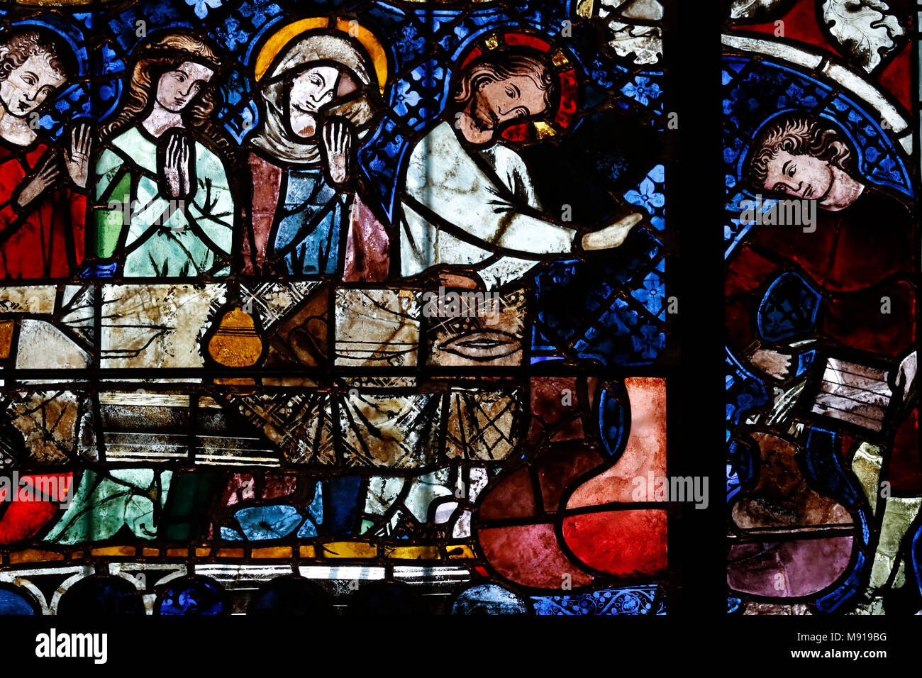 Our Lady of Strasbourg Cathedral. Stained glass window. The transformation of water into wine at the Marriage at Cana.  14 th century.  Strasbourg. Fr - Stock Image