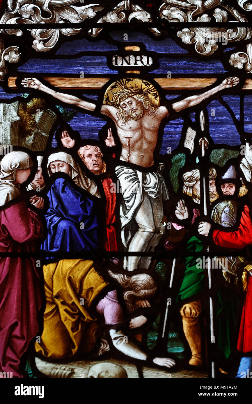 Saint-Pierre-le-Jeune Protestant Church. The crucifixion. JŽsus on the cross.  Stained glass window.  Strasbourg. France. - Stock Image