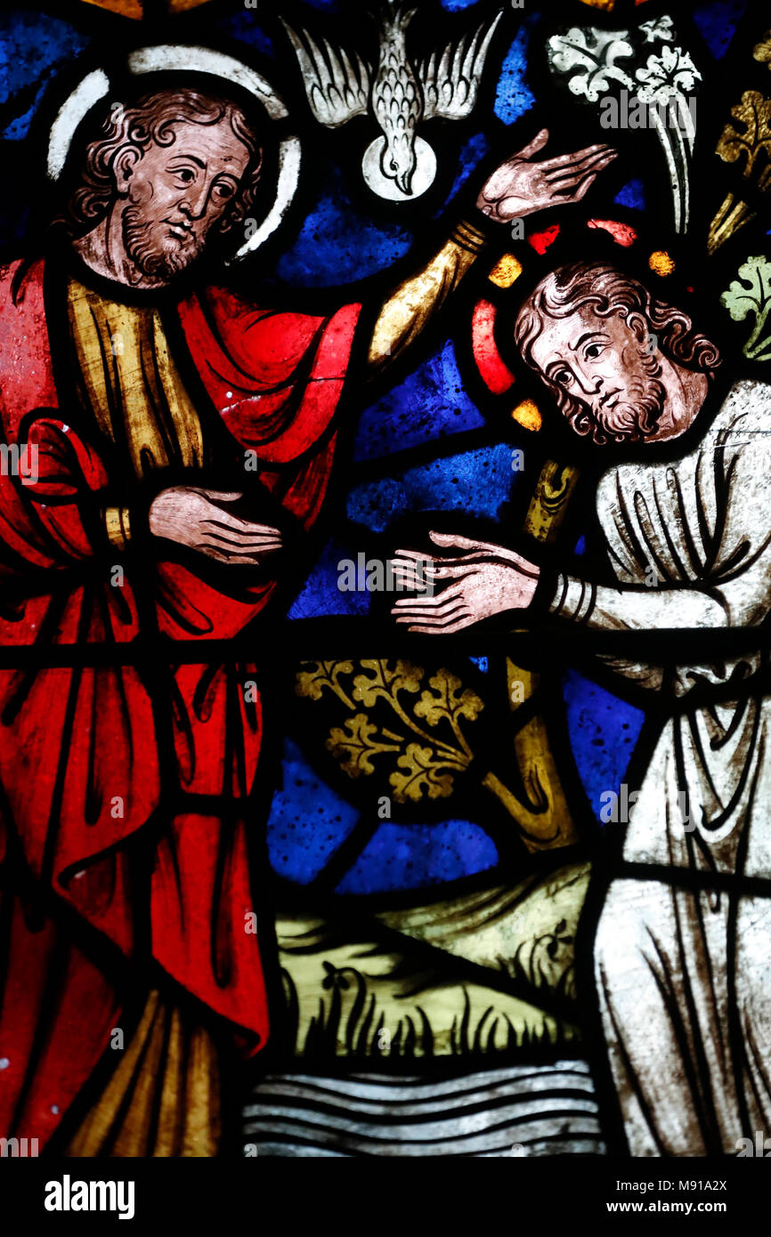 Saint-Pierre-le-Jeune Protestant Church.   The baptism of Jesus by John the Baptist.  Stained glass window.  Strasbourg. France. - Stock Image