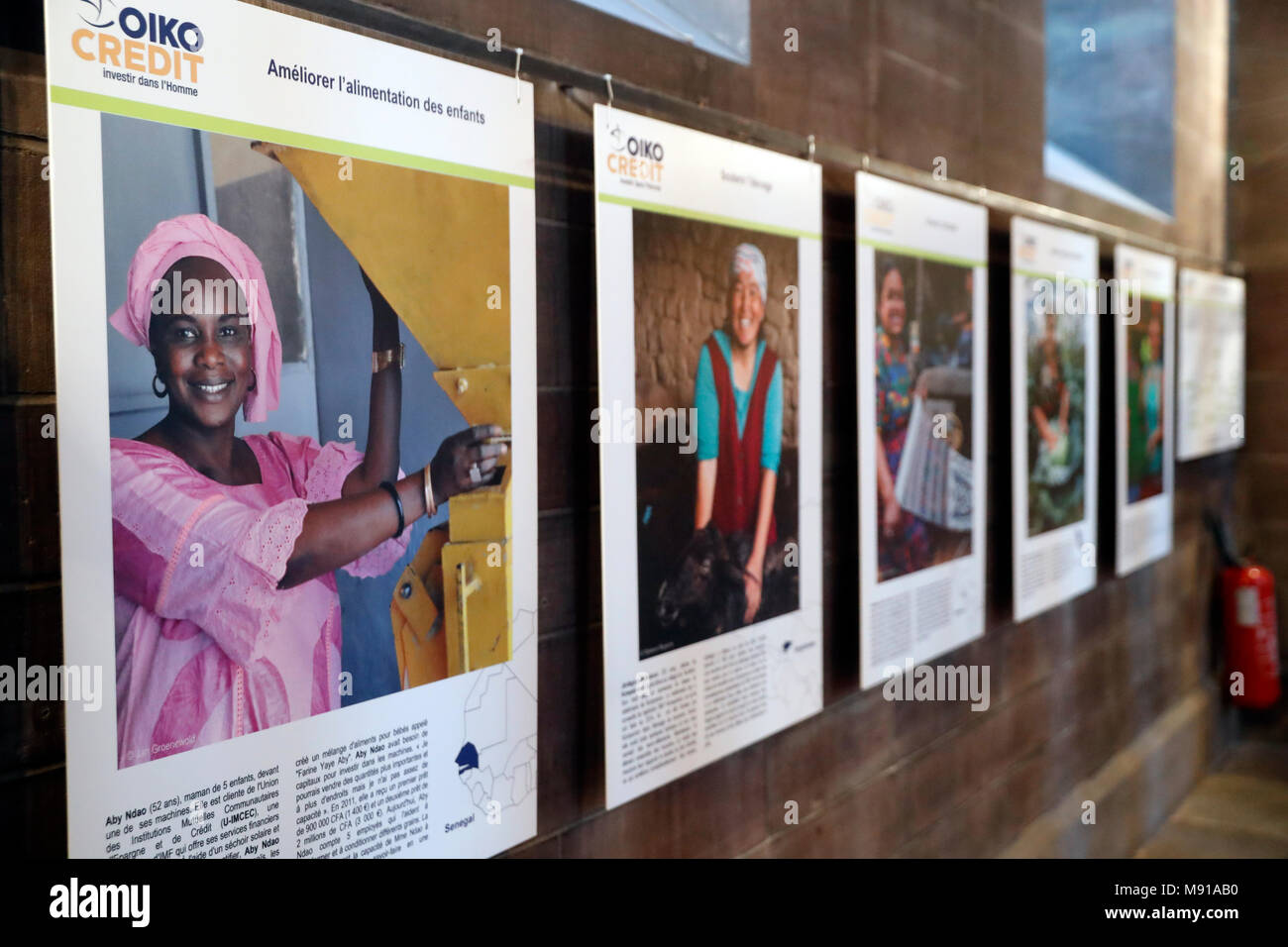 Oikocredit is a worldwide cooperative that promotes sustainable development by providing loans. Pictures exhibition.  Strasbourg. France. Stock Photo