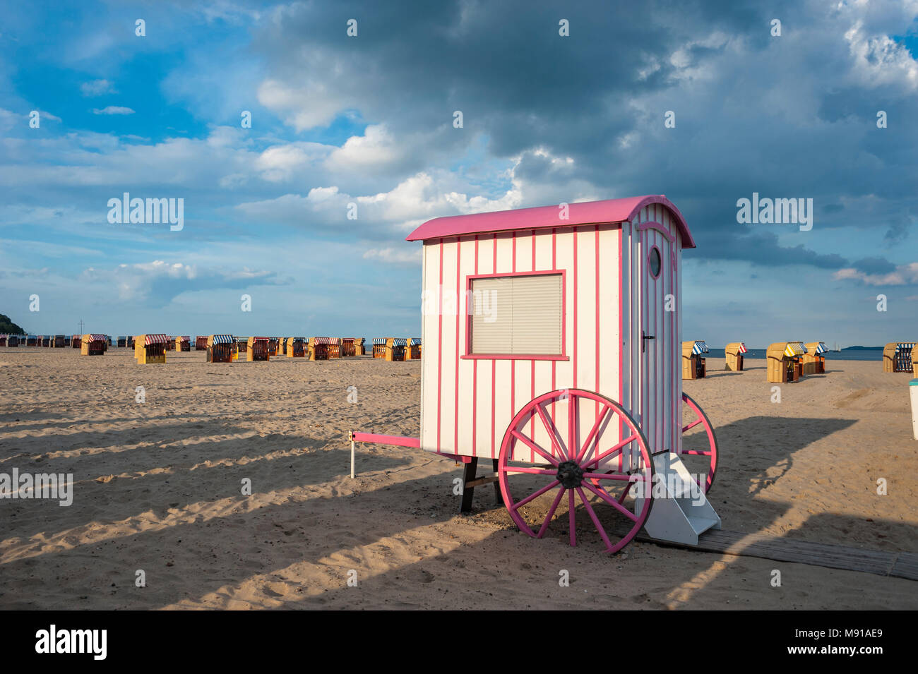 Historic bathing barrow also historic changing cubicle at the beach, Travemuende, Baltic Sea, Schleswig-Holstein, Germany, Europe - Stock Image