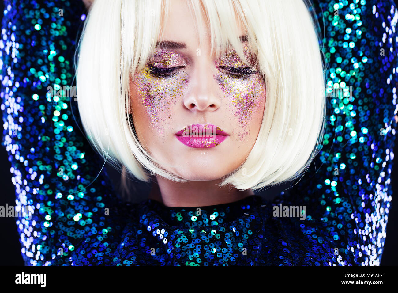 Beautiful Blonde Woman with Party Glitters Makeup Stock Photo