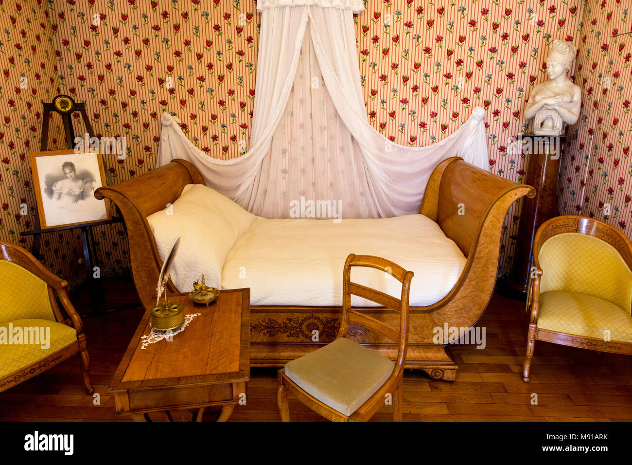 French 19th-century writer Chateaubriand's house in  Châtenay-Malabry, France. Juliette Récamier's bedroom with Charles X furniture. - Stock Image