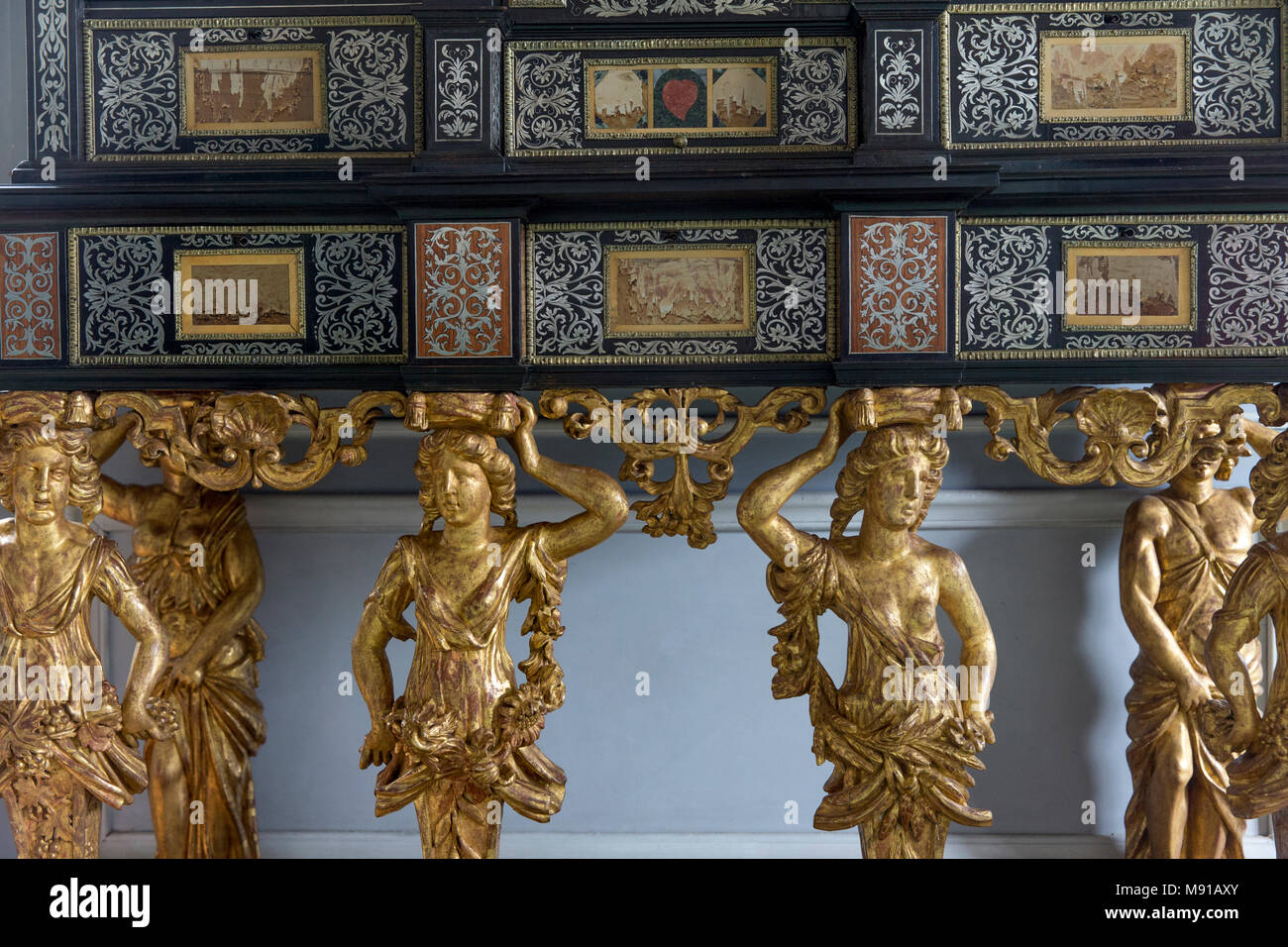 Vaux-le-vicomte castle. King's closet. Inlaid ebony and marquetry cabinet (detail). Caryatids symbolizing the 4 seasons. France. - Stock Image