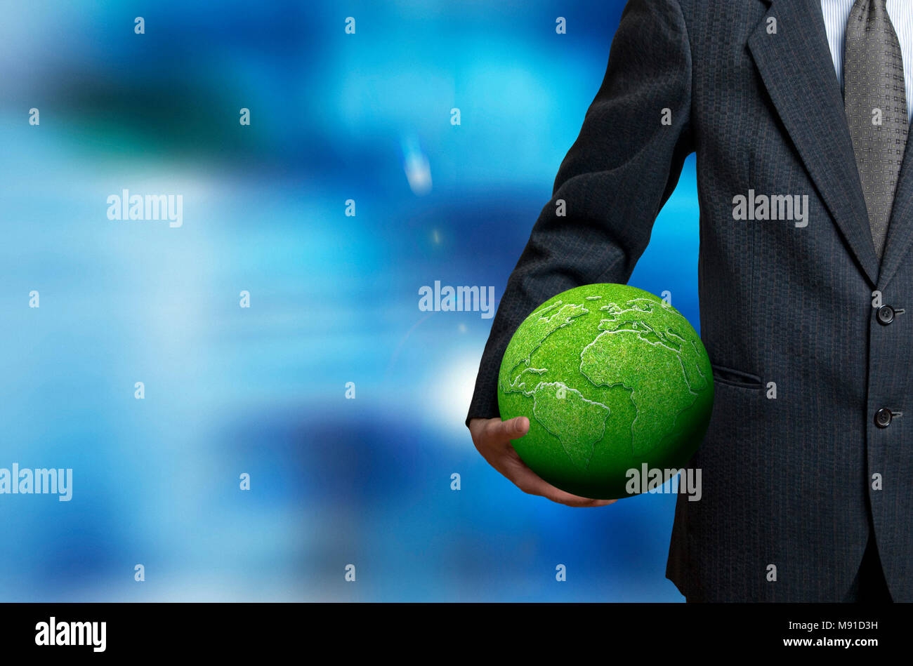 man holding a green earth - corporate social responsibility concept - Stock Image
