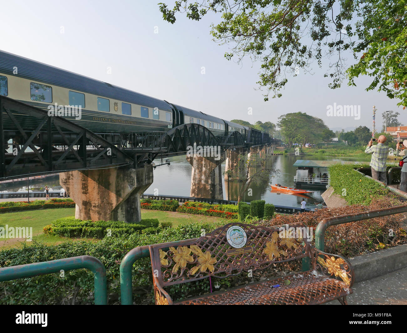 The Belmond Oriental Express train crossing over the Bridge of the River Kwai in Kanchanburi, Thailand - Stock Image
