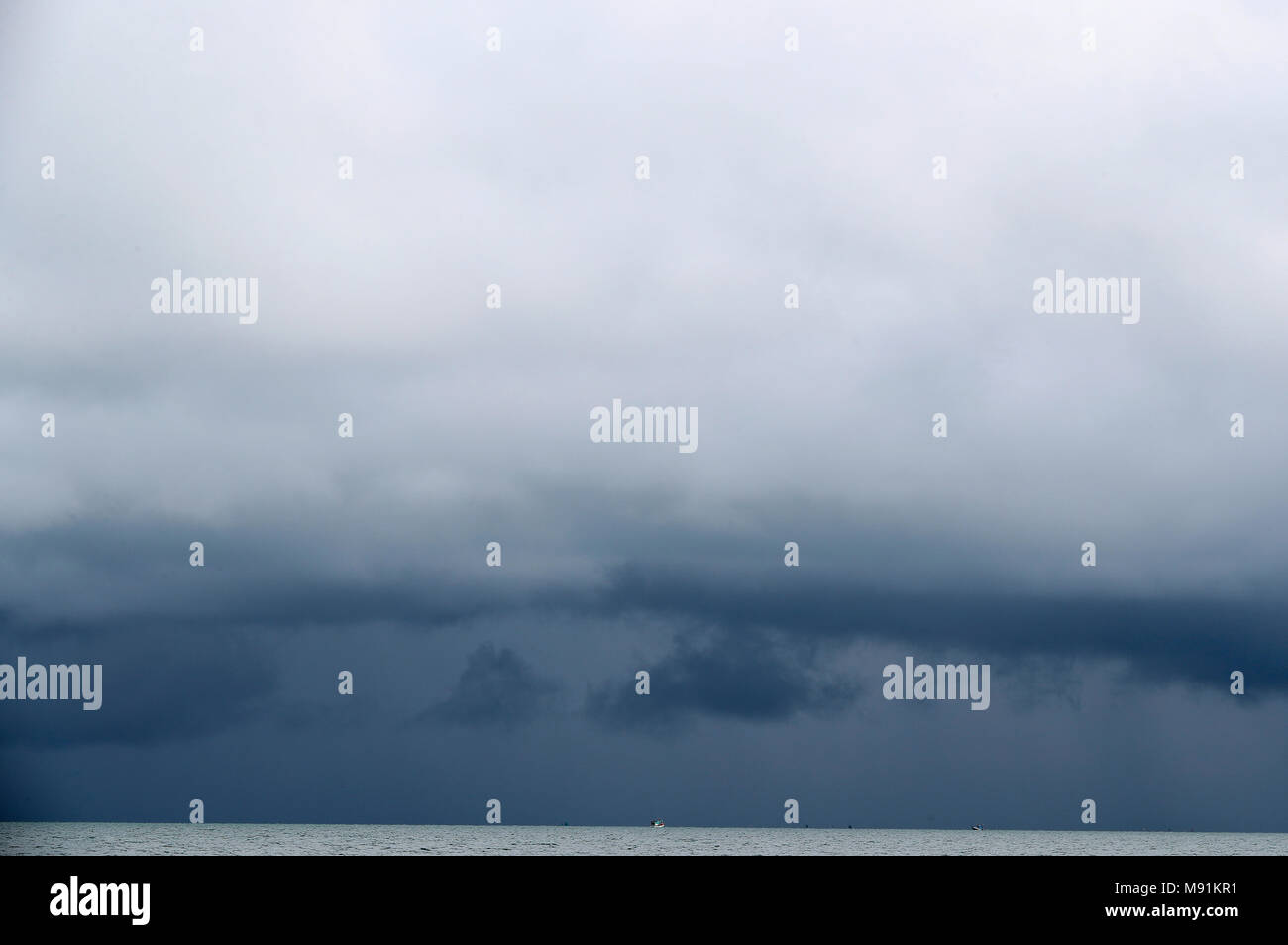 Monsoon season. Large storm clouds over South China sea.  Phu Quoc. Vietnam. - Stock Image