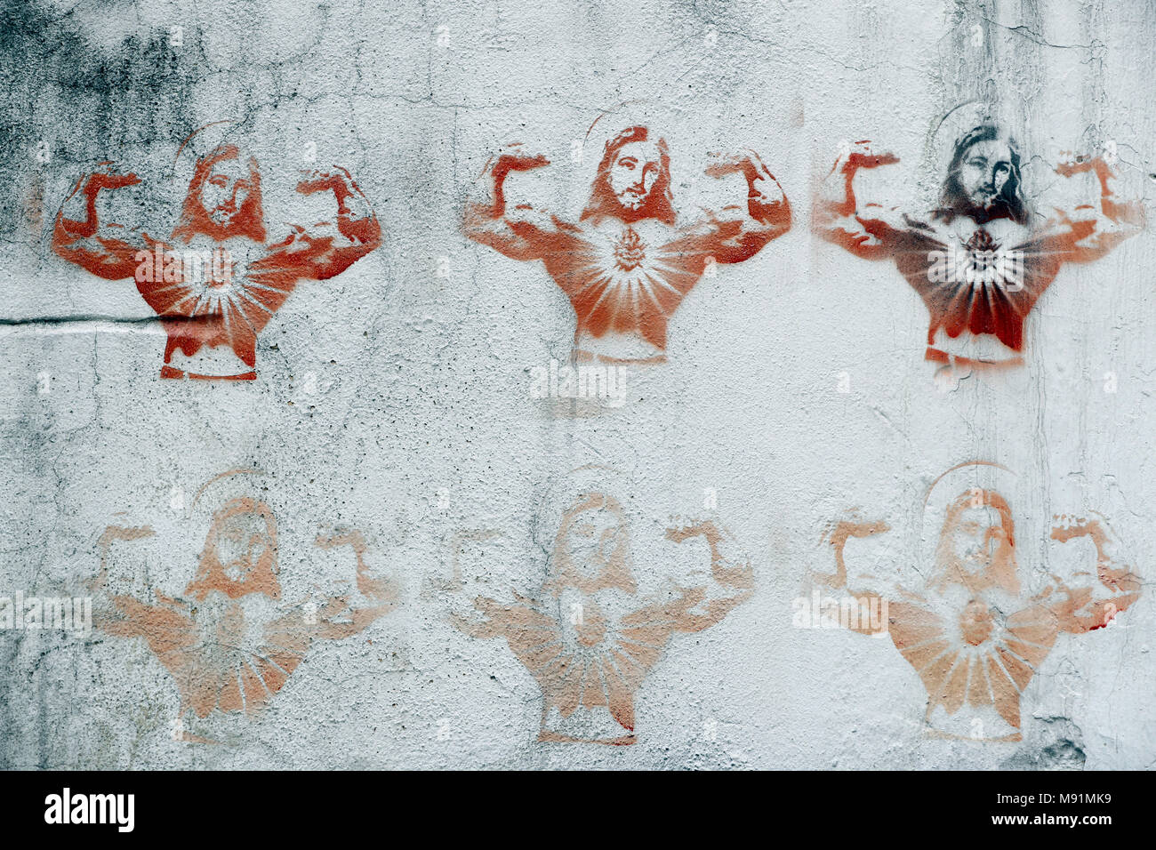 Stenciled image of Jesus Christ on a wall. Caricature.  Hanoi. Vietnam. - Stock Image