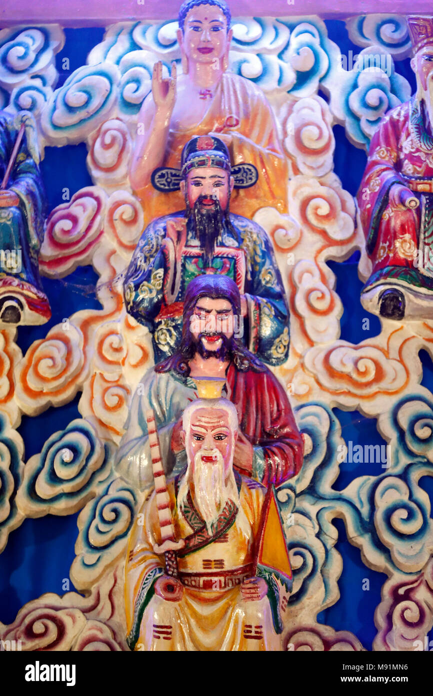 Cao Dai temple.   Lao Tseu, JŽsus, Bouddha and Confucius.  Phu Quoc. Vietnam. - Stock Image