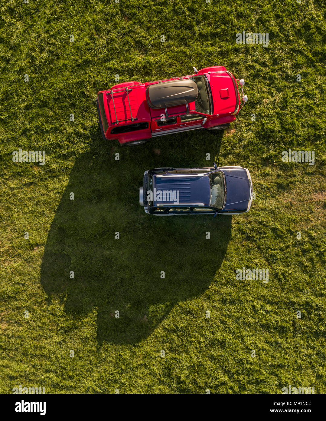 Aerial view of a Hilux truck and SUV. - Stock Image