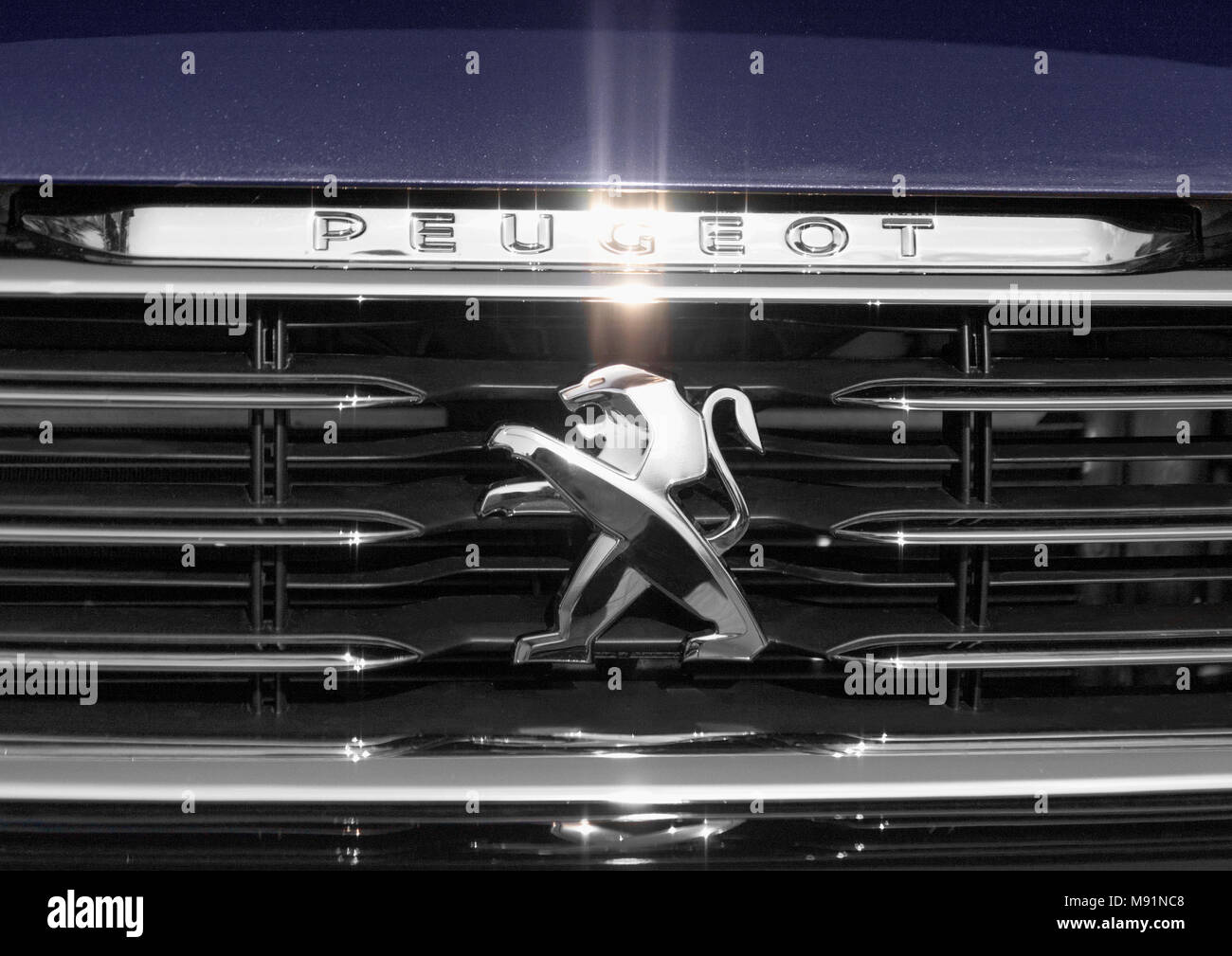 Warsaw, Poland. 29 August, 2014: Close up of the logo of Peuegot on the car front.Peuegot is a French automotive manufacturer, part of Groupe PSA. - Stock Image