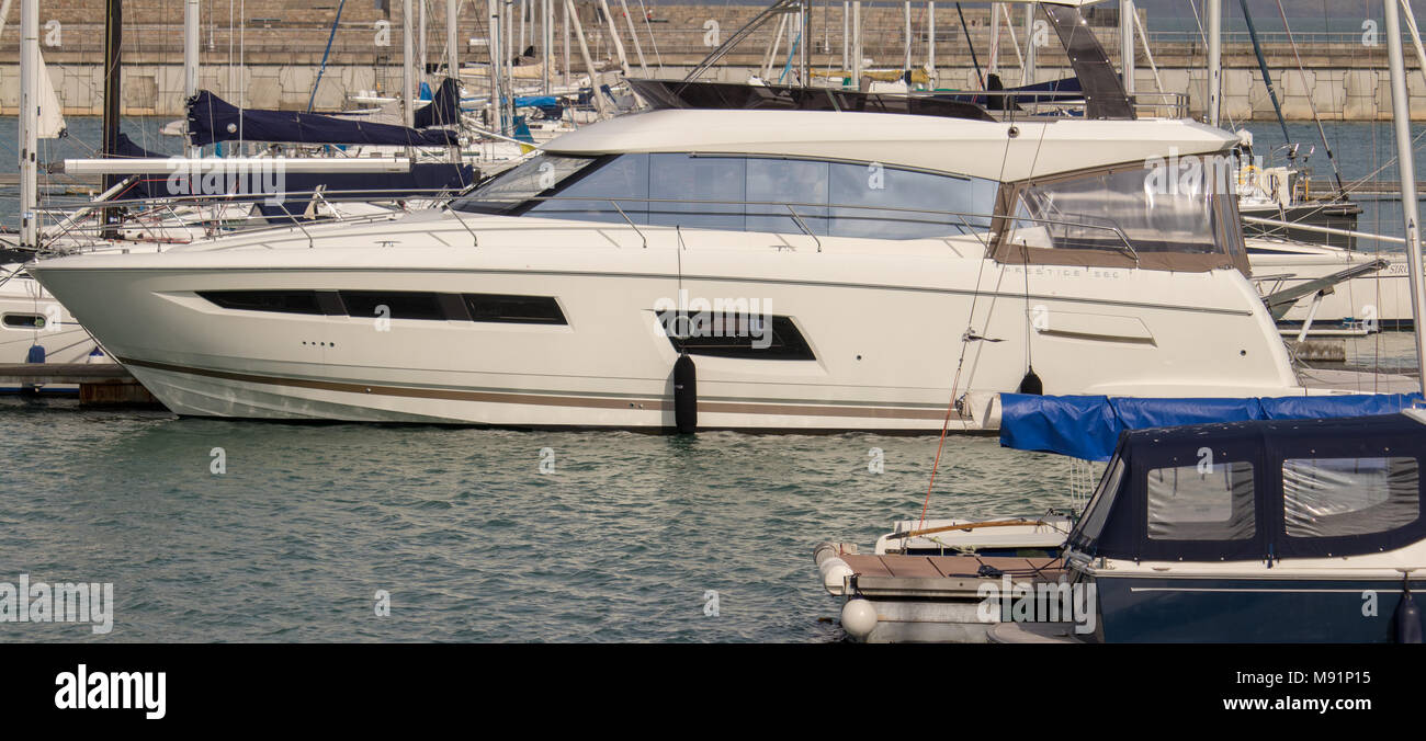 A 'Prestige 560' in Dun Laoghaire Marina. - Stock Image