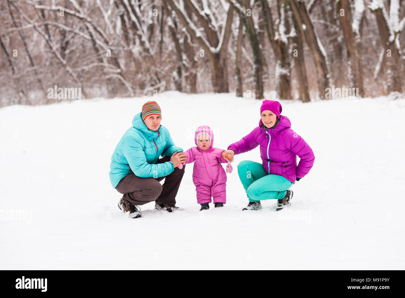 Family in the winter forest - Stock Image