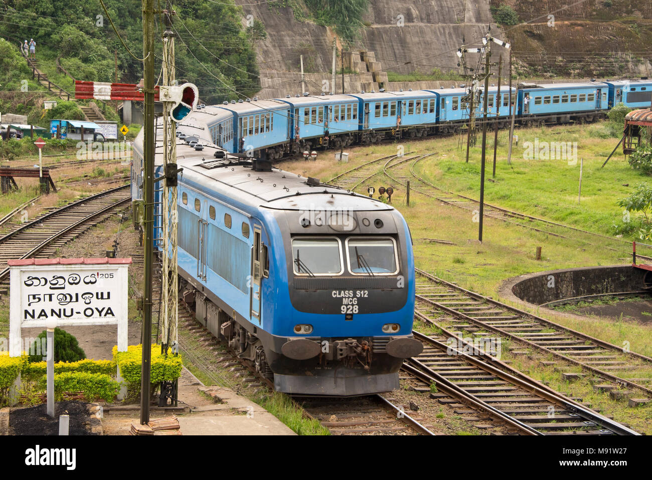 A class S12 MCG 928 diesel multiple-unit (DMU) train pulling in to Nanu Oya railway station, Sri Lanka. - Stock Image