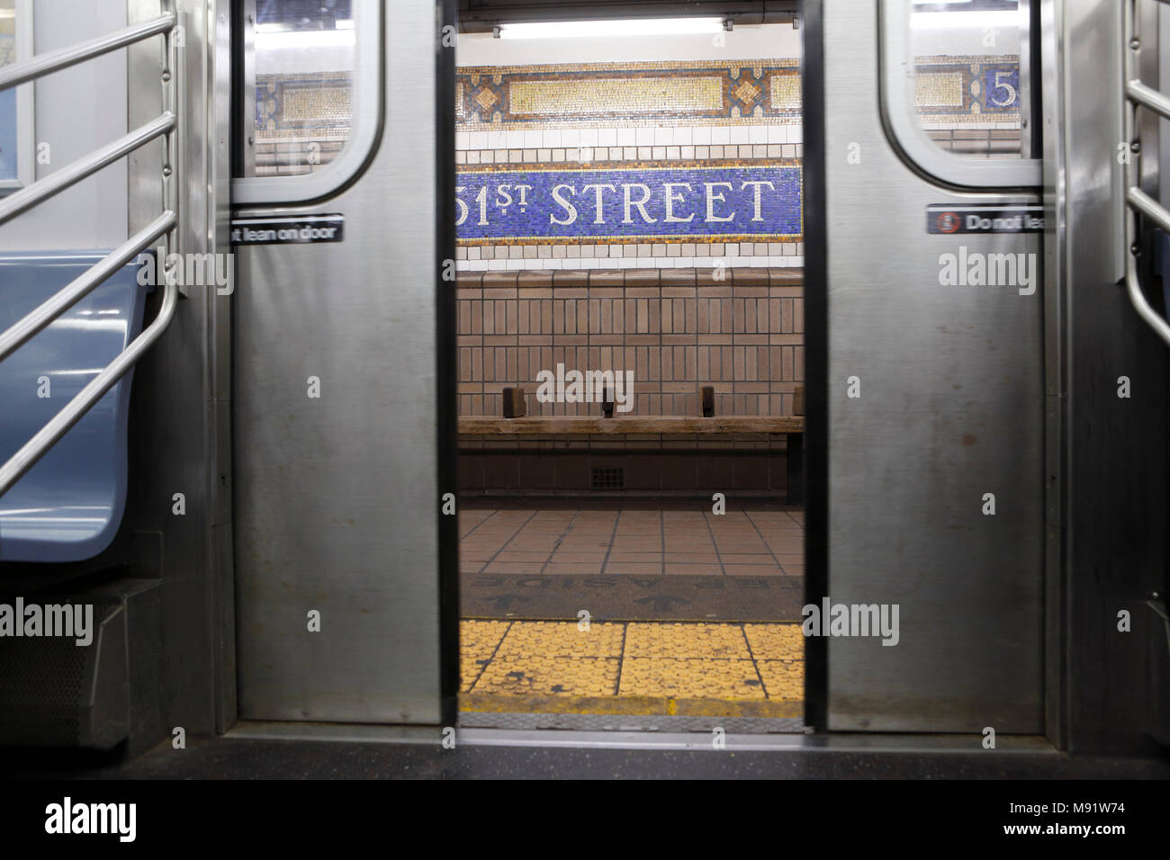 Opening doors of a NY subway train at the 51st Street station in New York City - Stock Image
