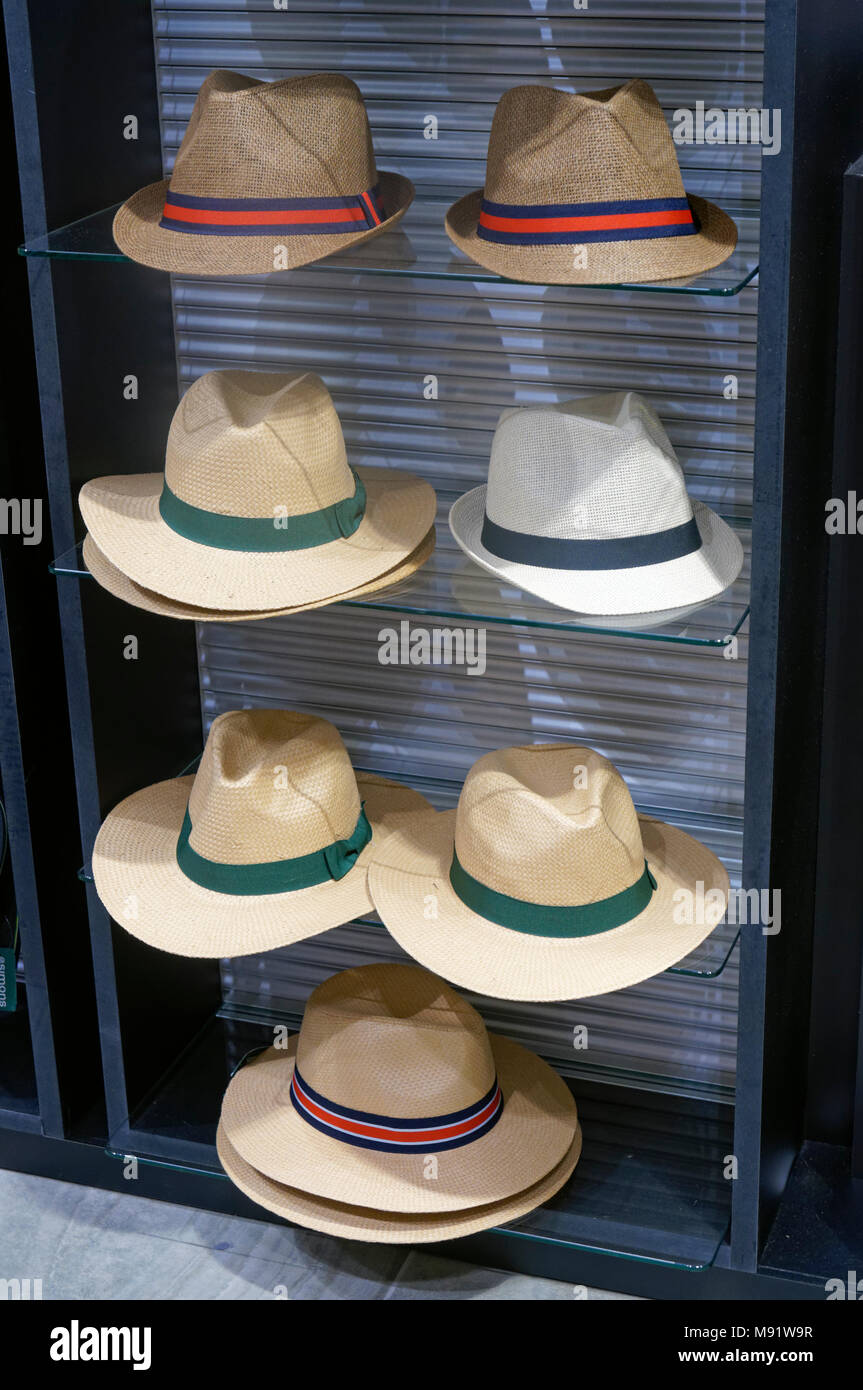 Men's straw fedora style hats for sale in Simons store at Park Royal South, West Vancouver, BC, Canada - Stock Image