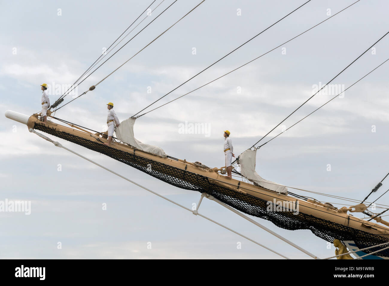 Barefoot sailors standing at attention on the bowsprit during the departure ceremony, Kaiwo Maru, Steveston, BC - Stock Image