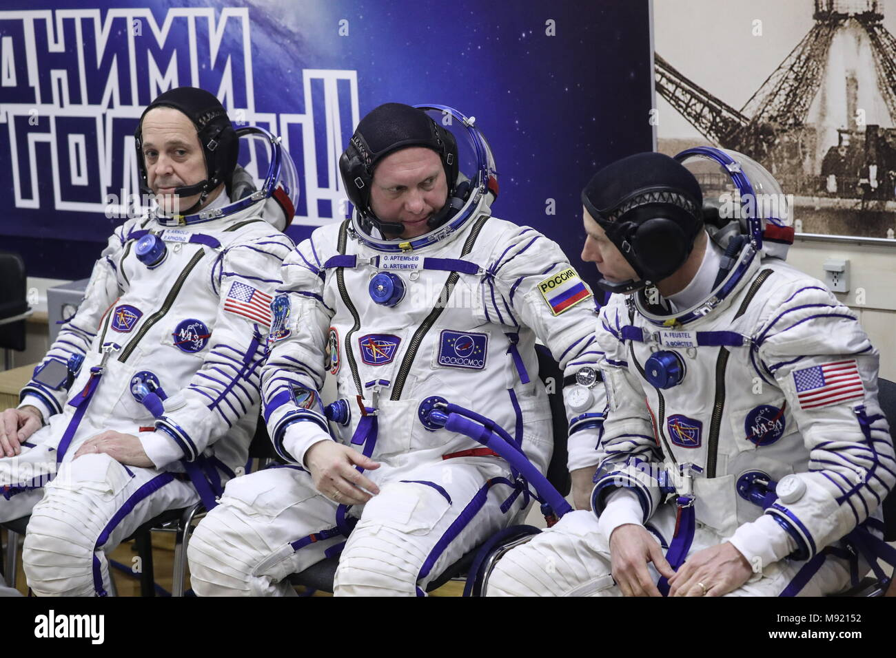 Baikonur Cosmodrome, Kazakhstan. 21st Mar, 2018. BAIKONUR, KAZAKHSTAN - MARCH 21, 2018: ISS Expedition 55/56 main crew members, NASA astronaut Richard Arnold, Roscosmos cosmonaut Oleg Artemyev, and NASA astronaut Andrew J. Feustel (L-R) in spacesuits before a launch to the International Space Station. The launch of a Soyuz-FG rocket booster carrying the Soyuz MS-08 spacecraft to the ISS from the Baikonur Cosmodrome is scheduled for March 21, 2018 at 20:44 Moscow time. Sergei Savostyanov/TASS Credit: ITAR-TASS News Agency/Alamy Live News - Stock Image