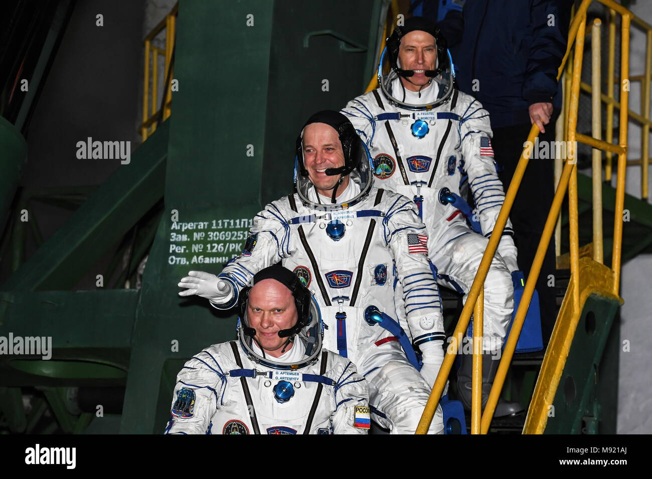 Baikonur Cosmodrome, Kazakhstan. 21st Mar, 2018. BAIKONUR, KAZAKHSTAN - MARCH 21, 2018: ISS Expedition 55/56 main crew members Roscosmos cosmonaut Oleg Artemyev, NASA astronauts Richard Arnold and Andrew J. Feustel (L-R) in spacesuits board the Soyuz MS-08 spacecraft before a launch to the International Space Station. The launch of a Soyuz-FG rocket booster carrying the Soyuz MS-08 spacecraft to the ISS from the Baikonur Cosmodrome is scheduled for March 21, 2018 at 20:44 Moscow time. Yevgenia Novozhenina/Sputnik/POOL/TASS Credit: ITAR-TASS News Agency/Alamy Live News - Stock Image