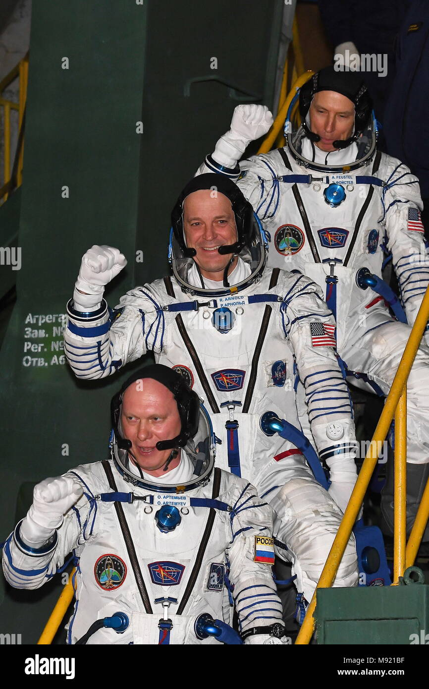 Kazakhstan. 21st Mar, 2018. BAIKONUR, KAZAKHSTAN - MARCH 21, 2018: ISS Expedition 55/56 main crew members, Roscosmos cosmonaut Oleg Artemyev, NASA astronauts Richard Arnold and Andrew J. Feustel (L-R) in spacesuits board the Soyuz MS-08 spacecraft before a launch to the International Space Station. The launch of a Soyuz-FG rocket booster carrying the Soyuz MS-08 spacecraft to the ISS from the Baikonur Cosmodrome is scheduled for March 21, 2018 at 20:44 Moscow time. Yevgenia Novozhenina/Sputnik/POOL/TASS Credit: ITAR-TASS News Agency/Alamy Live News - Stock Image