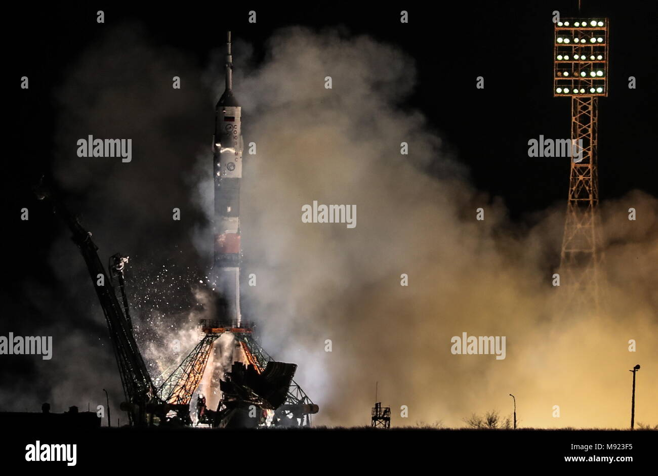 Kazakhstan. 21st Mar, 2018. KAZAKHSTAN - MARCH 21, 2018: A Soyuz-FG rocket booster carrying the Soyuz MS-08 spacecraft with the ISS Expedition 55/56 main crew of Roscosmos cosmonaut Oleg Artemyev and NASA astronauts Richard Arnold, Andrew J. Feustel aboard blasts off to the International Space Station from the Baikonur Cosmodrome. Sergei Savostyanov/TASS Credit: ITAR-TASS News Agency/Alamy Live News - Stock Image