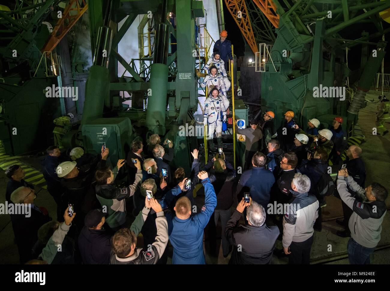 Baikonur Cosmodrome, Kazakhstan. 21st Mar, 2018.  International Space Station Expedition 55 crew boards the Russian Soyuz MS-08 rocket for lifts off from the Baikonur Cosmodrome March 21, 2018 in Baikonur, Kazakhstan. Russian cosmonaut Oleg Artemyev, bottom, of Roscosmos and American astronauts Ricky Arnold, center, and Drew Feustel, top, of NASA will spend the next five months living and working aboard the International Space Station. Credit: Planetpix/Alamy Live News - Stock Image