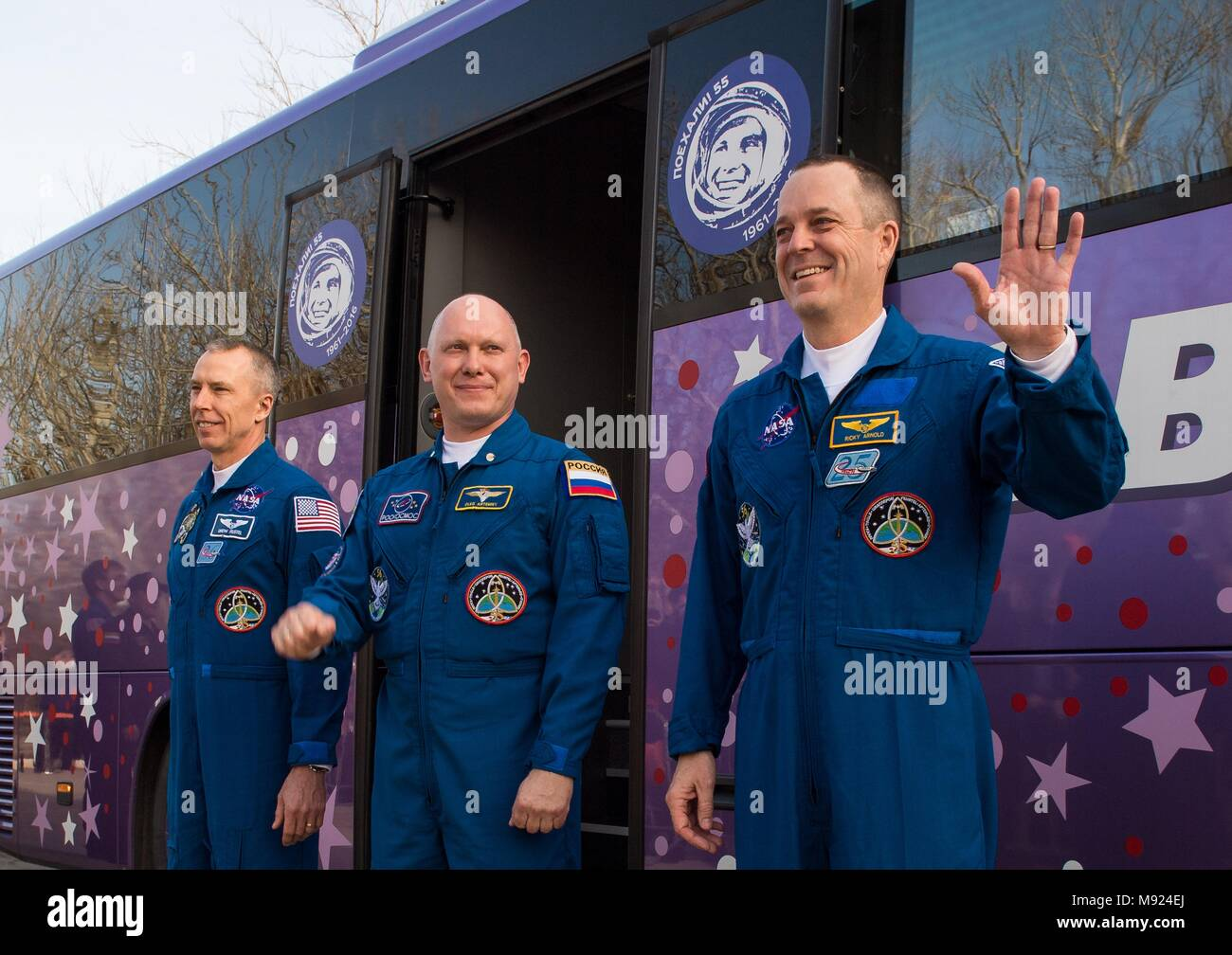 Baikonur Cosmodrome, Kazakhstan. 21st Mar, 2018.  International Space Station Expedition 55 crew Drew Feustel of NASA, left, Soyuz Commander Oleg Artemyev of Roscosmos, center, and flight engineer Ricky Arnold of NASA, right, wave farewell to family and friends as they depart the Cosmonaut Hotel to suit-up for their Soyuz launch to the International Space Station from the Baikonur Cosmodrome March 21, 2018 in Baikonur, Kazakhstan. Credit: Planetpix/Alamy Live News - Stock Image