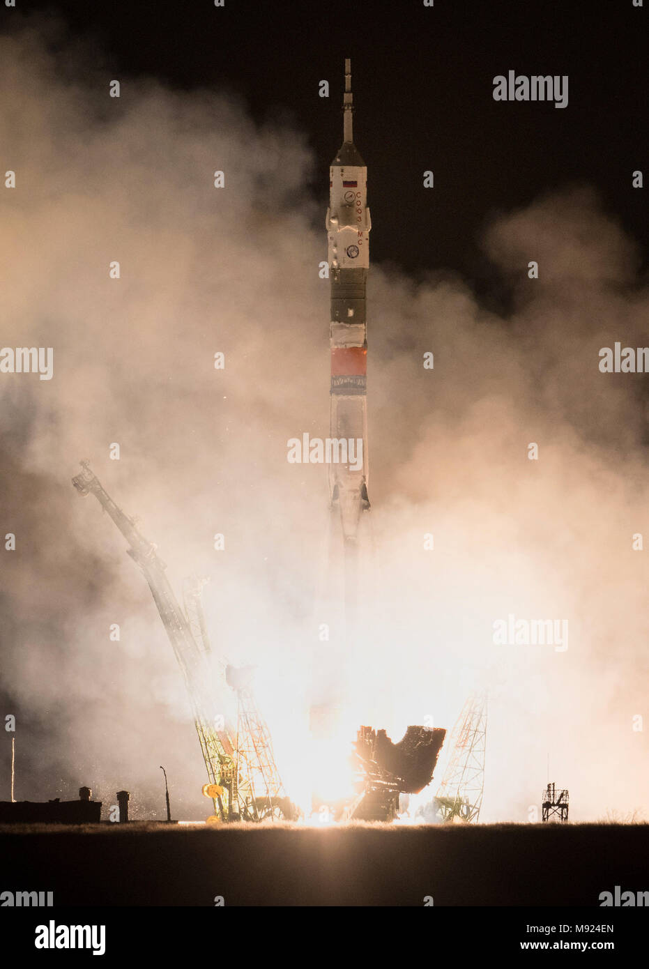 Baikonur Cosmodrome, Kazakhstan. 21st Mar, 2018.  The Russian Soyuz MS-08 rocket lifts off carrying the International Space Station Expedition 55 crew from the Baikonur Cosmodrome March 21, 2018 in Baikonur, Kazakhstan. Russian cosmonaut Oleg Artemyev of Roscosmos and American astronauts Ricky Arnold and Drew Feustel of NASA will spend the next five months living and working aboard the International Space Station. Credit: Planetpix/Alamy Live News - Stock Image