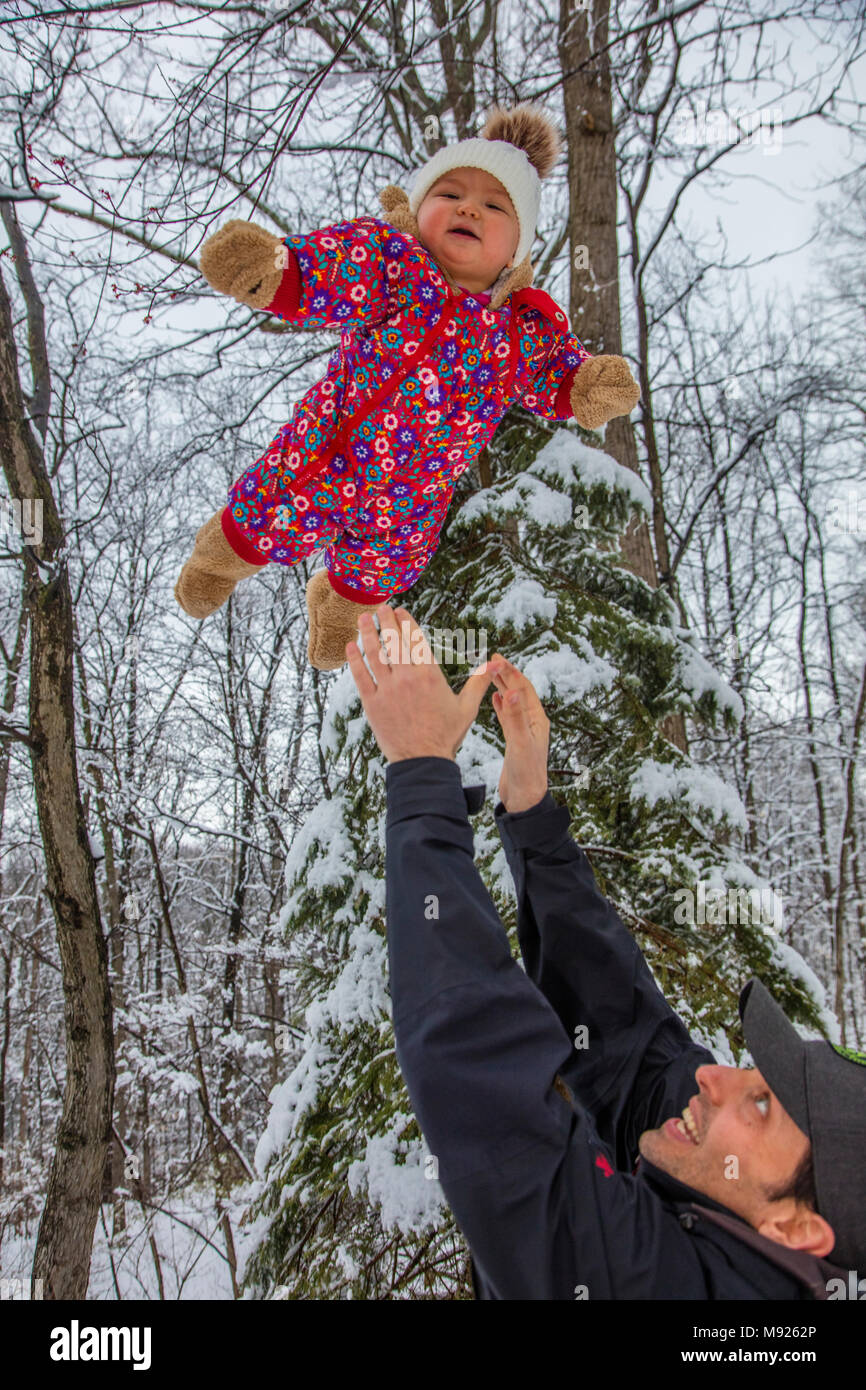 Baby girl in snow with father, Washington D.C. area, Maryland, March 21, 2018, storm dropped around 6 inches of snow closing schools,  governement offices and many businesses, model released Credit: John Cancalosi/Alamy Live News - Stock Image