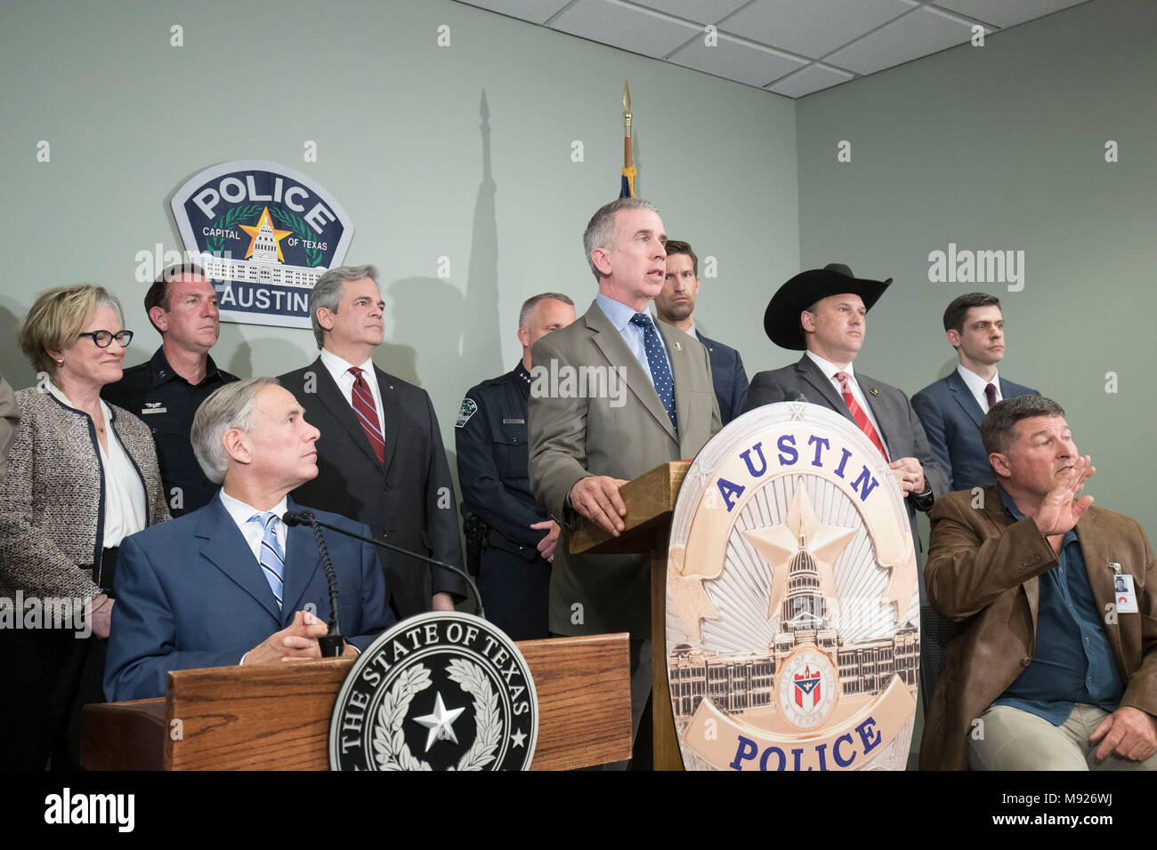 Bureau of Alcohol, Tobacco and Firearms Special Agent in Charge Fred Milanowski answers questions at a press conference with Texas Gov. Greg Abbott (seated at left) and others who assisted in finding alleged Austin serial bomber Mark A. Conditt. Conditt killed himself as police closed in on him on March 21. - Stock Image