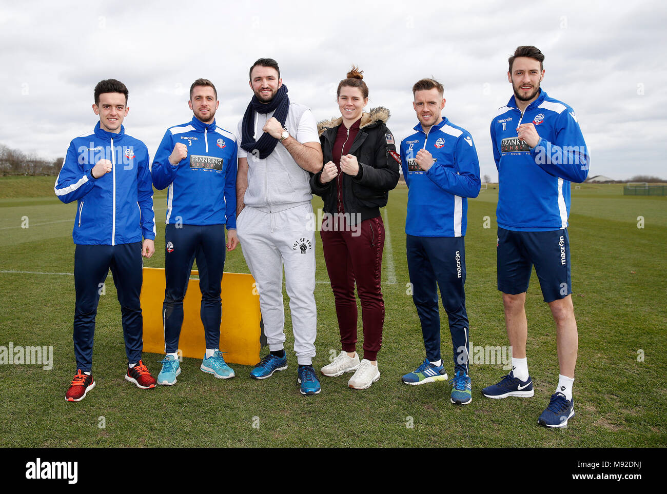 Hughie Fury (centre Left) Savannah Marshall (centre right) and Bolton Wanderers players (left-right) Zach Clough, Andrew Taylor, Craig Noone and Will Buckley, during a workout with Bolton Wanderers players at the BWFC Academy, Bolton. - Stock Image