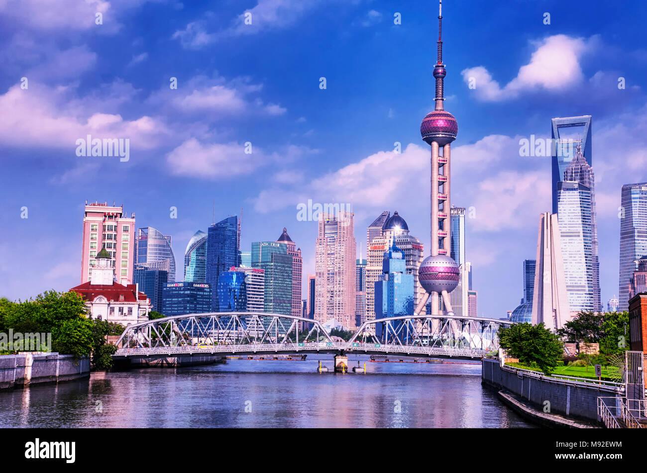 July 15, 2015.  Shanghai, China.  The Waibaidu (garden) bridge over the Wusong River (Suzhou Creek) with the modern buildings of Lujiazui in the backg Stock Photo