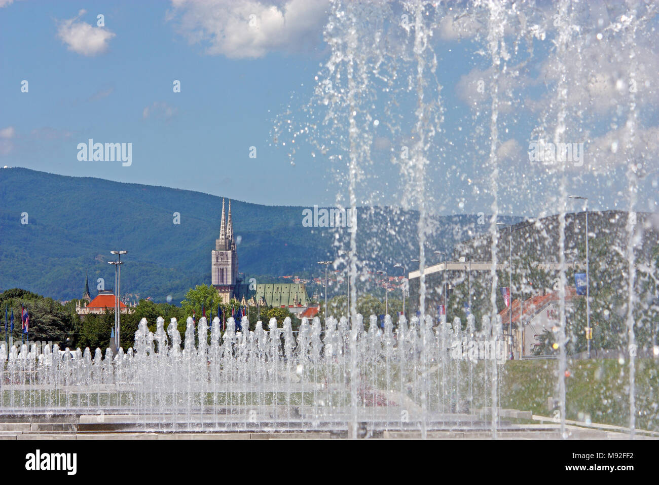 View of Zagreb cathedral behind the water curtain - Stock Image