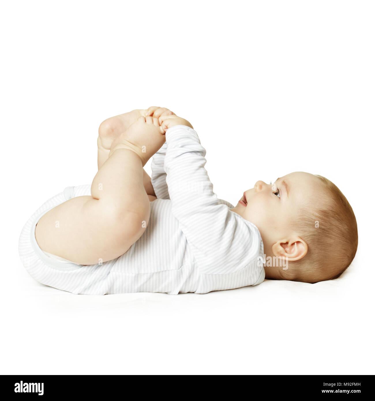 Lying baby looking up - Stock Image